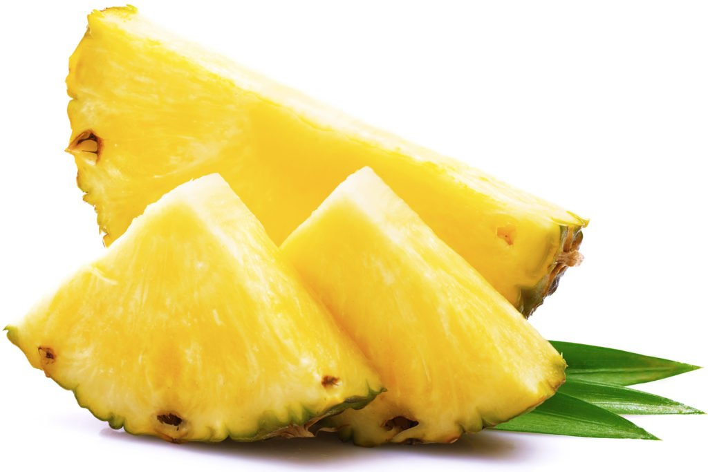 Pineapple fruit cut into chunks on a white background
